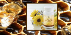 the honey and honeycomb inside a bee hive with an image overlay of Forever Living Bee Pollen