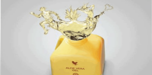 Opened bottle of Forever Living Aloe Vera drinking gel, with aloe liquid coming out top and forming a man, an aloe plant and a love heart