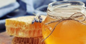 bee hive honey comb and honey in a jar